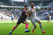 Peterborough United defender Niall Mason (24) battles for possession  with Milton Keynes Dons forward Jordan Bowery (9) during the EFL Sky Bet League 1 match between Milton Keynes Dons and Peterborough United at stadium:mk, Milton Keynes, England on 24 August 2019.