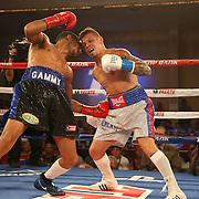 Gamalier Rodriguez (blue/black trunks) retains his NABO Featherweight Title against challenger Orlando Cruz (white trunks) at the Bahia Shriners Center on Saturday, April 19, 2014 in Orlando, Florida.  (AP Photo/Alex Menendez)