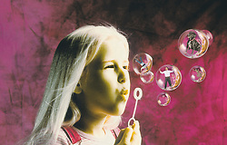 Young girl blowing bubbles bubble with encapsulated captured people animals