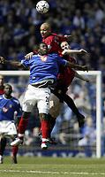 YAKUBU gets beaten to the ball by BROWN<br /> Portsmouth vs. Mancester Utd.<br /> Fratton Park<br /> Premiership<br /> 17/4/04<br /> <br /> Photo SEAN RYAN / FOTOSPORTS INTERNATIONAL