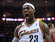 Apr 19, 2010; Cleveland, OH, USA; Cleveland Cavaliers forward LeBron James (23) celebrates after a dunk during the first period against Chicago Bulls in game two in the first round of the 2010 NBA playoffs at Quicken Loans Arena. Mandatory Credit: Jason Miller-US PRESSWIRE