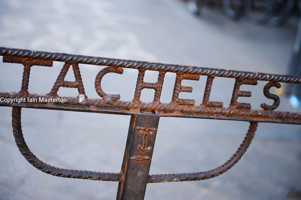 Steel sign at entrance to Tacheles art workshop space on Oranienburger Strasse in Berlin Germany