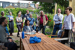 London, UK. 22 May, 2019. Caroline Lucas, Green Party MP for Brighton Pavilion, visits Marsden Road Centre for Wildlife Gardening with Scott Ainslie and Gulnar Hasnain, who top the Green Party list in London, during campaigning for the European elections.