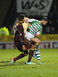 Yeovil Town's Jamie McAllister catches Watford's Mathias Ranegie with an elbow in the face - Photo mandatory by-line: Joe Meredith/JMP - Tel: Mobile: 07966 386802 18/02/2014 - SPORT - FOOTBALL - Yeovil - Huish Park - Yeovil Town v Watford - Sky Bet Championship