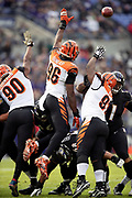 Cincinnati Bengals defensive end Michael Johnson (90), Bengals defensive end Carlos Dunlap (96), and Bengals defensive tackle Geno Atkins (97) leap while trying to block a Baltimore Ravens kick during the NFL week 11 regular season football game against the Baltimore Ravens on Sunday, Nov. 18, 2018 in Baltimore. The Ravens won the game 24-21. (©Paul Anthony Spinelli)