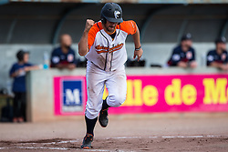 Guillaume Felices raise his fit while delivering an RBI single during the 2015 French Finals.