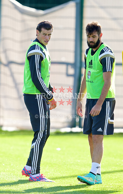 NEWPORT, WALES - Tuesday, October 7, 2014: Wales' captain Ashley Williams and Joe Ledley training at Dragon Park National Football Development Centre ahead of the UEFA Euro 2016 qualifying match against Bosnia and Herzegovina. (Pic by David Rawcliffe/Propaganda)