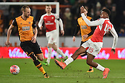 Alex Iwobi of Arsenal FC (45) kicks ball past Hull City midfielder David Meyler (7)  during the The FA Cup fifth round match between Hull City and Arsenal at the KC Stadium, Kingston upon Hull, England on 8 March 2016. Photo by Ian Lyall.