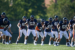 The Virginia defense warms up at practice.  The Virginia Cavaliers football team during an open practice on August 9, 2008 at the University of Virginia's football turf field in Charlottesville, VA.