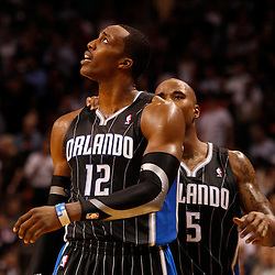 March 3, 2011; Miami, FL, USA; Orlando Magic center Dwight Howard (12) and shooting guard Quentin Richardson (5) react after Howard is called for a foul during the fourth quarter against the Miami Heat at the American Airlines Arena. The Magic defeated the Heat 99-96.    Mandatory Credit: Derick E. Hingle