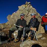 Michael Naiman and Seah Johnson sign a summit guest book stored in a metal box on the rim of the east crater during a summit of Mount Rainier on June 30, 2015. The iconic Pacific Northwest volcano is a popular challenge for mountaineers.  (Joshua Trujillo, seattlepi.com)