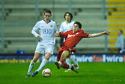 WARRINGTON, ENGLAND - Thursday, March 12, 2009: Liverpool's Daniel Pacheco and Manchester United's Robert Brady during the FA Premiership Reserves League (Northern Division) match at the Halliwell Jones Stadium. (Photo by David Rawcliffe/Propaganda)