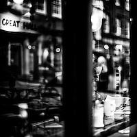 Elderly male sitting alone in a cafe