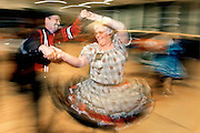 Richard Barrett and Lana McKean square dance in the Will Rogers High School gym in Tulsa, OK.