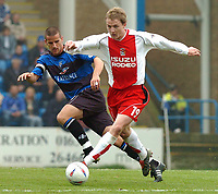 PICTURE HELEN BATT, DIGITALSPORT<br /> NORWAY ONLY<br /> <br /> GILLINGHAM VS COVENTRY<br /> GILLINGHAM'S CHRIS HOPE  CHALLENGES WITH COVENTRY'S GARY MCSHEFFREY ,1ST MAY 2004.