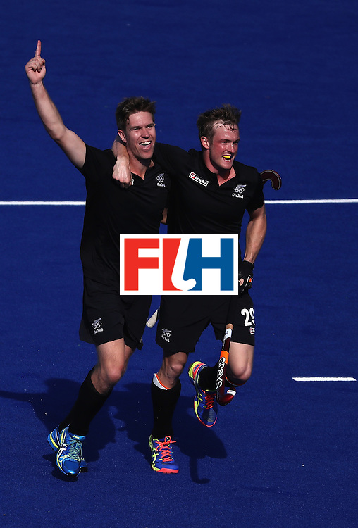 RIO DE JANEIRO, BRAZIL - AUGUST 06:  James Coughlan #1 and Hugo Inglis #29 of New Zealand react to a goal during a Pool A match between New Zealand and Austraiia  on Day 1 of the Rio 2016 Olympic Games at the Olympic Hockey Centre on August 6, 2016 in Rio de Janeiro, Brazil.  (Photo by Sean M. Haffey/Getty Images)