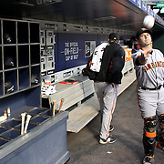 NEW YORK, NEW YORK - APRIL 29:  Catcher Buster Posey #28 of the San Francisco Giants tosses a signed baseball to a fan preparing to bat in the dugout during the New York Mets Vs San Francisco Giants MLB regular season game at Citi Field on April 29, 2016 in New York City. (Photo by Tim Clayton/Corbis via Getty Images)