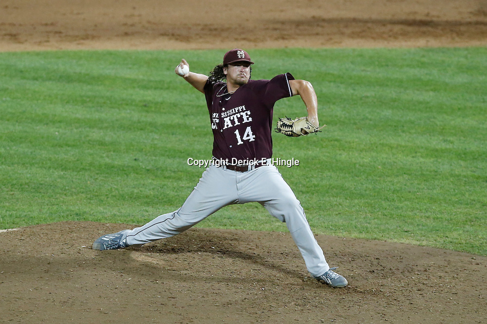 Jun 25, 2013; Omaha, NE, USA; Mississippi State Bulldogs pitcher Jonathan Holder (14) delivers a pitch during the seventh inning in game 2 of the College World Series finals against the UCLA Bruins at TD Ameritrade Park. Mandatory Credit: Derick E. Hingle-USA TODAY Sports