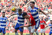 Queens Park Rangers defender Jake Bidwell (3) gets to the ball ahead of Middlesbrough defender Daniel Ayala (4) and Queens Park Rangers defender Grant Hall (4) during the EFL Sky Bet Championship match between Middlesbrough and Queens Park Rangers at the Riverside Stadium, Middlesbrough, England on 23 February 2019.