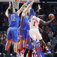 21 December 2015: Los Angeles Clippers forward Lance Stephenson (1) goes for the pass around Oklahoma City Thunder forward Kyle Singler (5) and Oklahoma City Thunder center Steven Adams (12) during the Oklahoma City Thunder 100-99 victory over the Los Angeles Clippers, at the Staples Center, Los Angeles, California, USA.