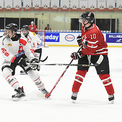 WHITBY, - Dec 13, 2015 -  WJAC Game 2- Team Switzerland vs Team Canada East at the 2015 World Junior A Challenge at the Iroquois Park Recreation Complex, ON. Tobias Geisser #20 of Team Switzerland tries to keep the puck from Grant Cooper #10 of Team Canada East during the first period.(Photo: Andy Corneau / OJHL Images)