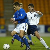 St Johnstone v Ross County....06.12.03<br />Paul Bernard is closed down by David Hannah<br /><br />Picture by Graeme Hart.<br />Copyright Perthshire Picture Agency<br />Tel: 01738 623350  Mobile: 07990 594431