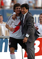 08/10/06 -Bs.As. - Argentina - RIVER PLATE (3) Vs. BOCA Jrs. (1) in the Argentine Football Derby . Match at the River Plate Monumental Stadium.<br /> Here  River Plate GONZALO HIGUAIN celebrating with head coach DANIEL PASSARELLA.<br /> Torneo Apertura 2006/2007.<br /> © Argenpress.com / PikoPress