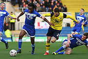 Hartlepool United defender Peter Kioso (2) battles for possession  with Oxford United forward Jamie Mackie (19) during the The FA Cup match between Oxford United and Hartlepool United at the Kassam Stadium, Oxford, England on 4 January 2020.