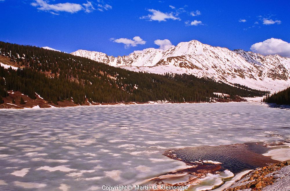 A frozen Clinton Reservoir below the snow covered 13,951 ft. Fletcher Mountain along the Continental Divide of the Ten Mile Range.  Colorado.