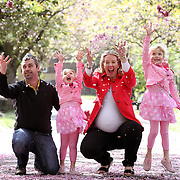 Spring time with tree blossom, Maternity, Mum, Dad, Sisters Family Photograph Wandsworth, South West London.
