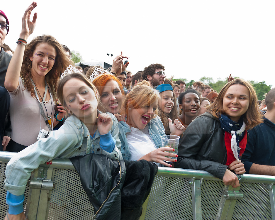 © Licensed to London News Pictures. 02/06/2012. London, UK. The front row of the audience enjoy Metronomy's performance at Field Day Festival, Victoria Park, London.  Photo credit : Richard Isaac/LNP