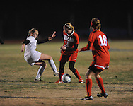 Oxford High's Zoe Scruggs (3) vs. Lafayette High's Alley Houghton (3) in girls soccer action on Tuesday, December 10, 2013. The match ended in a 5-5 tie.
