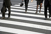 detail of businesspeople on a pedestrian crossing Tokyo Japan