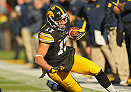 November 23 2013: Iowa Hawkeyes wide receiver Jacob Hillyer (17) slides to the ground after a reception during the first quarter of the NCAA football game between the Michigan Wolverines and the Iowa Hawkeyes at Kinnick Stadium in Iowa City, Iowa on November 23, 2013. Iowa defeated Michigan 24-21.