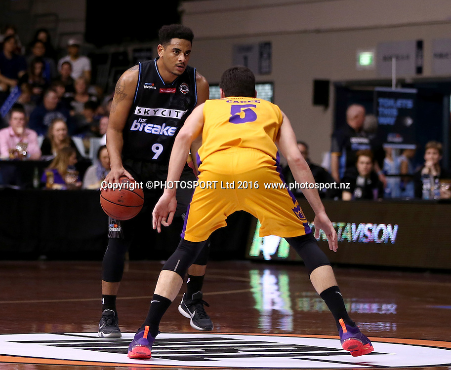 Breakers` Corey Webster is challenged by Kings` Jason Cadee in the Round 3 ANBL Basketball Match, New Zealand Breakers v Sydney Kings, North Shore Events Centre, Auckland, New Zealand, Thursday, October 20, 2016. Copyright photo: David Rowland / www.photosport.nz