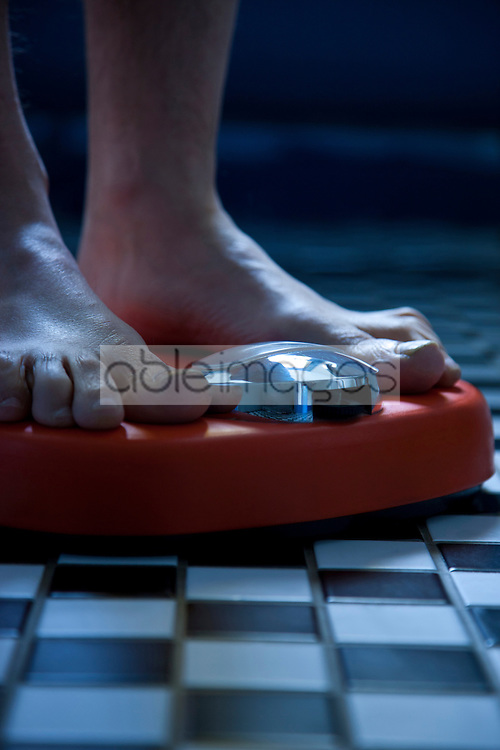 Close up of Feet on Weighing Scale