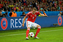 LILLE, FRANCE - Friday, July 1, 2016: Wales' Chris Gunter sets up the third goal against Belgium during the UEFA Euro 2016 Championship Quarter-Final match at the Stade Pierre Mauroy. (Pic by David Rawcliffe/Propaganda)