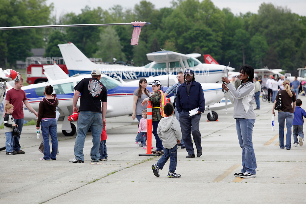 Montgomery, New York - People look at planes on the runway during the Touch-A-Truck event to benefit the United Ways of Orange and Dutchess counties at Orange County Airport on May 14, 2011.