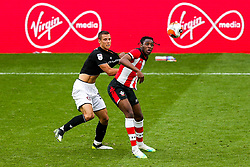 Moussa Djenepo of Southampton is challenged by Filip Benkovic of Bristol City during a friendly match before the Premier League and Championship resume after the Covid-19 mid-season disruption - Rogan/JMP - 12/06/2020 - FOOTBALL - St Mary's Stadium, England - Southampton v Bristol City - Friendly.