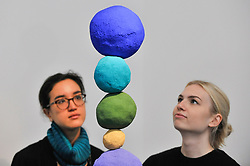 "© Licensed to London News Pictures. 12/10/2017. London, UK.  Staff members view ""Stack 7, Ultramarine Blue"", 2017, by Annie Morris (Est. GBP5-7k) at a preview of artworks for the ""Art for Grenfell"" auction taking place at Sotheby's, New Bond Street, on 16 October.  Leading contemporary artists have agreed to donate works to the auction, the proceeds of which will be divided equally amongst the 158 surviving families of the Grenfell Tower fire by the Rugby Portobello Trust charity. Photo credit : Stephen Chung/LNP"