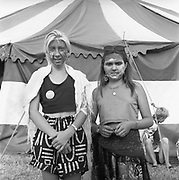 Face-painted girls behind a tent at Glastonbury, 1989.
