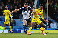 Gary Deegan of Southend (centre) is held off by Jason Banton of Plymouth Argyle (right) during the Sky Bet League 2 match at Roots Hall, Southend<br /> Picture by David Horn/Focus Images Ltd +44 7545 970036<br /> 10/01/2015