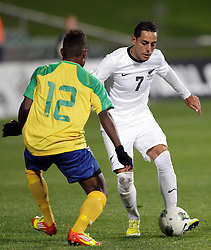 New Zealand's Leo Bertos is challenged by Solomon Islands' Gagame Feni in a FIFA World Cup Qualifier Match, North Harbour Stadium, Auckland, New Zealand, Tuesday, September 11, 2012.  Credit:SNPA / David Rowland