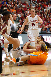 Dec 20, 2011; Stanford CA, USA;  Tennessee Lady Volunteers forward/center Isabelle Harrison (right) and Stanford Cardinal guard Toni Kokenis (center) fight for a loose ball during the first half at Maples Pavilion.  Stanford defeated Tennessee 97-80. Mandatory Credit: Jason O. Watson-US PRESSWIRE