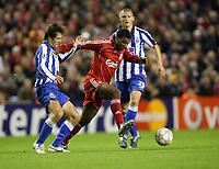 Photo: Paul Greenwood/Sportsbeat Images.<br />Liverpool v Porto. UEFA Champions League. 28/11/2007.<br />Liverpool's  Ryan Babel (C) skips past the challenge of Marek Cech