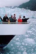 Tourists onboard the Klondike Express catamaran take an up close look at the Harvard Glacier in Prince William Sound, once heavily polluted by crude oil caused by the Exxon Valdez tanker. This image was taken 12 years after the disaster, with the area still suffering from the disaster. A research team from the University of North Carolina estimated in 2003 that the habitats in the area would need 30 years to recover. Shell recently abandoned their oil exploration offshore in the Chukchi Sea, citing dissappointing finds. Yet, the arctic region still holds plenty hydrocarbons, and onshore production is still pumping oil through the forty year old Alyeska 1 pipeline to the Valdez oil terminal. The state is totally dependant on royalties from the oil, and the need for revenue may push the state to amp up their production – especially now that the prices are low.