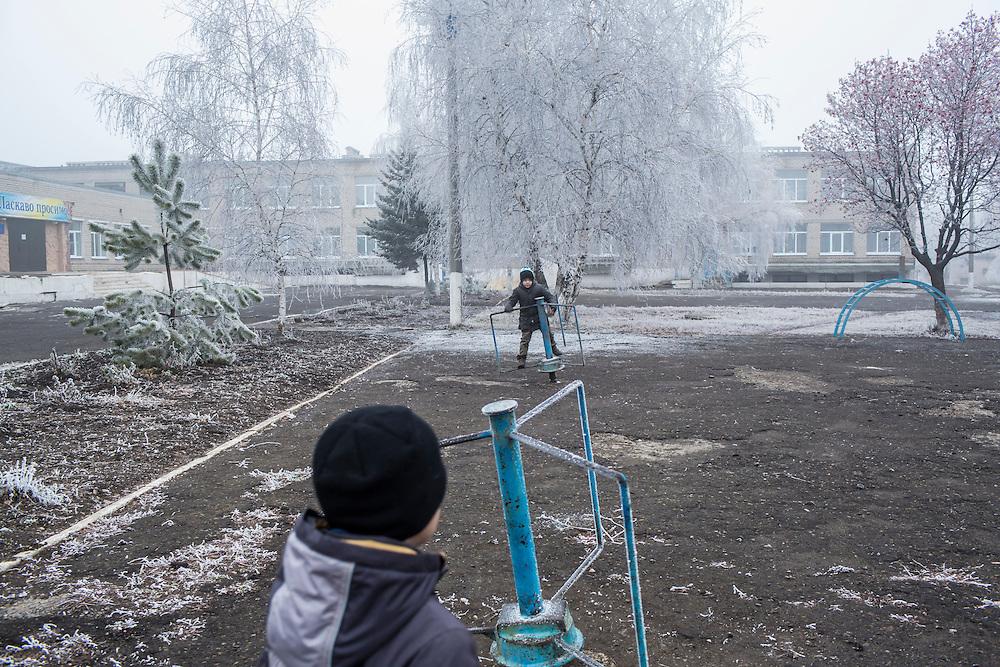 Children play on the school playground on Saturday, December 12, 2015 in Zolote, Ukraine.