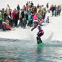 Mason Bush makes a good attempt to cross the pond during Gunstock's annual B.Y.O.D.C. Pond Skimming event on Sunday afternoon.  (Karen Bobotas/for the Laconia Daily Sun)