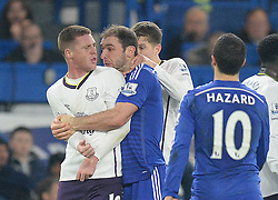 Evertons John Stones grips Chelsea's Branislav Ivanovic throat with both hands, who has a hold of Everton's James McCarthy - Photo mandatory by-line: Alex James/JMP - Mobile: 07966 386802 - 11/02/2015 - SPORT - Football - London - Stamford Bridge - Chelsea v Everton - Barclays Premier League