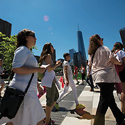 """June 21, 2014 - New York, NY : <br /> The city was flooded with music on Saturday as Make Music New York brought more than 1,300 free concerts to the city's streets and parks. The annual festival's program included """"And Death Shall Have No Dominion,"""" a piece by composer Pete M. Wyer, honoring the centenary of the birth of the poet Dylan Thomas. The piece -- a participatory singing event -- was performed by a synchronized headphone choir. The choir's singers began in smaller groups around lower Manhattan and culminated in a meeting in Battery Park City. The sopranos, who began their walk at Bleecker Playground in Greenwich Village, walk down the Hudson River Greenway on their way to the meeting point in Nelson A. Rockefeller Park. CREDIT: Karsten Moran for The New York Times"""